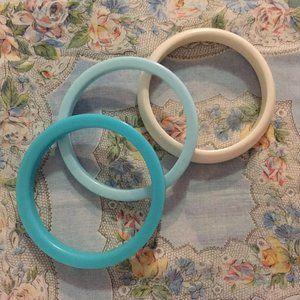 Three vintage acrylic bracelets
